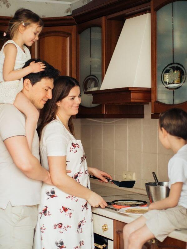 a happy family cooking together in the kitchen